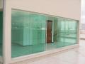 fechamento em vidro temperado verde.jpg